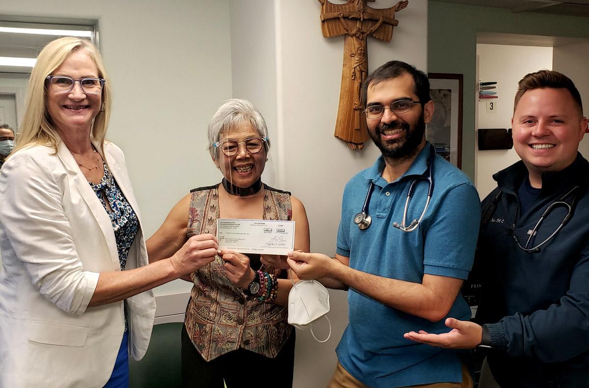 Berks Genesis presented with highmark grant check